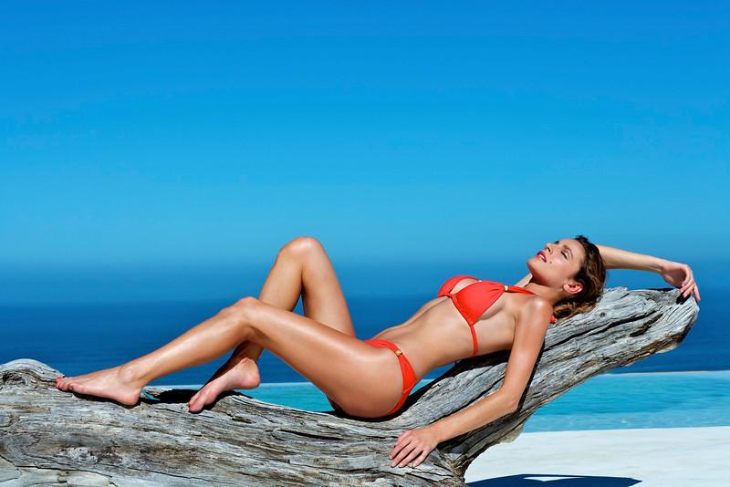 Beautiful brunette lying on the beach