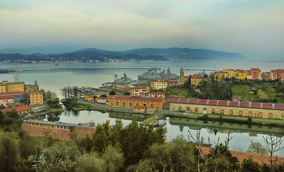 View over La Spezia, a Commercial and Industrial port town on the Mediterranean. Early spring, 6pm. I like the mix here...industrial, farm, military, domestic, mountains and sea...