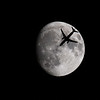 """A Delta Air Lines flight bound for New York from Cincinnati is seen silhouetted by a waxing gibbous moon over Central Pennsylvania on December 19, 2018. The Boeing 737-832, painted in """"SkyTeam Livery"""" was flying at approximately 24,825 ft."""