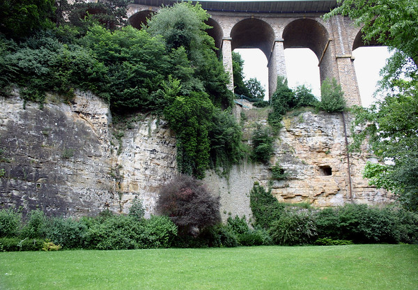 """Pétrusse Casemates (stone tunnels) from along the valley floor - up to the Paserelle Bridge or Luxembourg Viaduct (also called the """"Old Bridge"""") - Luxembourg City"""