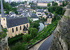 "From atop the Castle Bridge - to the Church of St. John the Baptist - the Alzette River flowing up through the Grund quarters - and the Chemin de la Corniche (chemin means ""way"" and cornice is a horizontal ledge structure in architecture), also known as the ""Balcony of Europe"", along the Plateau du Saint Esprit"