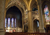 From the end of the main nave, at the crossing with the transept - with the high altar at the choir and stained glass windows of the apse beyond - Church of Our Lady - Notre Dame Cathedral of Luxembourg