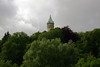 Over the trees in the Pétrusse Valley - to the tower of the State and Savings Bank - along the cloudy Luxembourg City sky