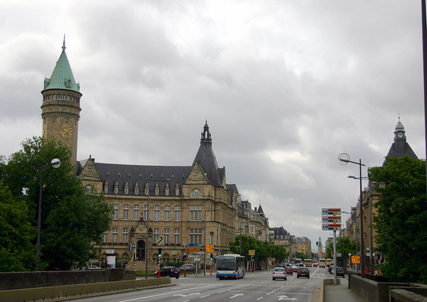 "Across the Adolphe Bridge - into the Gare quarters, at the Place du Metz - with the State Savings Bank's head office building and tower (L), which was the building that the headquarters for General Omar Bradley was based, in 1944-1945, while the critical ""Battle of the Bulge"" raged in the northern part of Luxembourg and neighbouring Belgium - then down the Avenue de la Liberte (the Avenue of Liberty), which intersects the Railway Station - Luxembourg CIty"