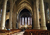 Down the main nave between the arched columns - to the high altar at the choir - with the stained glass windows upon the apse beyond - Church of Our Lady - Notre Dame Cathedral of Luxembourg