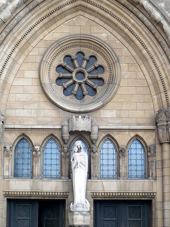 Mother Mary below the rose window at the depressed stone arch above the portal to the Church of Our Lady - the Notre Dame Cathedral of Luxembourg
