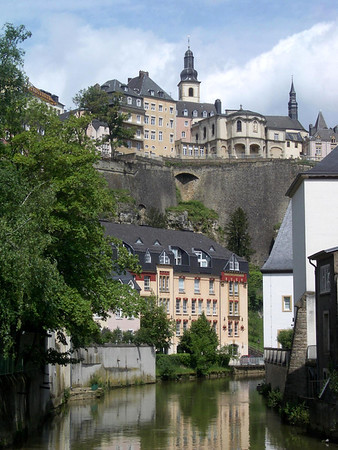 Along the Alzette River in the Grund quarters - up to the Chemin de la Corniche - and the tower and steeple of the St. Michaels Church - Luxembourg City