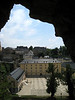 Beyond a gallery opening of the, Casemates of the Rocher du Bock, to the courtyard of the Abby of Neumunster (1606)