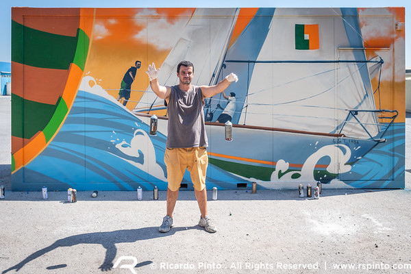 Portuguese graffiti artists working on the sponsors containers for the Regata de Portugal in Lisboa, Portugal