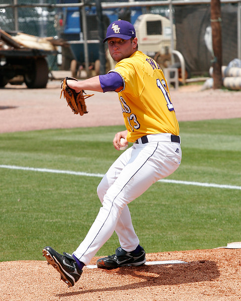 LSU pitcher Jordan Brown warms up.