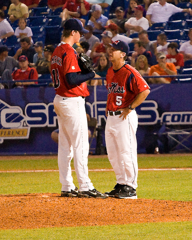 Ole Miss coach, Mike Bianco, meets on the mound with 2008 All SEC Freshman Team pitcher Drew Pomeranz during SEC Tournament. (art effect)
