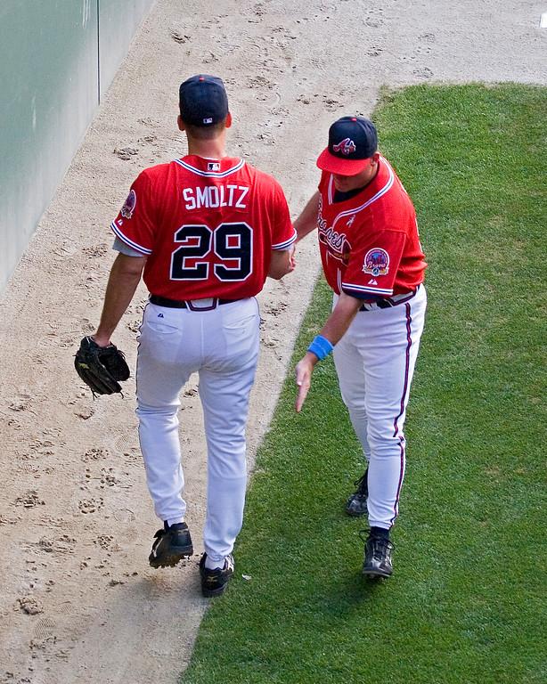 Braves pitcher Smoltz pat on the butt for good luck or spanking as he leaves bullpen?