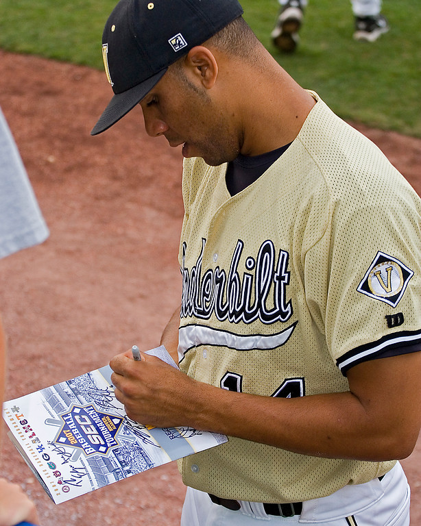 David Price signing autographs at SEC Tournament.  He won numerous awards to include: Dick Howser Trophy Winner, Golden Spikes Award Winner, Collegiate Baseball's Co-National Player of the Year, CSTV's College Player of the Year, First-Team All-American by Collegiate Baseball, National Collegiate Baseball Writers Association and Rivals.com Brooks Wallace Award Winner, Roger Clemens Award Finalist, SEC Male Athlete of the Year, SEC Pitcher of the Year, First Team All-SEC, No. 1 Overall Draft Pick (Tampa Bay Devil Rays)
