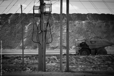 A large CAT 7930 haul dump truck carries a load of coal used for power generation out of the Black Thunder pit.