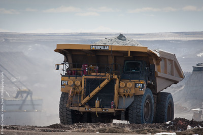 A CAT 7930 hauls earth to the processing plant out of a Black Thunder pit.