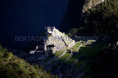 first light shining on the the pyramid at Machu Picchu, Peru
