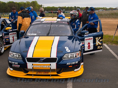 Andy Pilgrim getting into the K-Pax Racing Volvo S60.