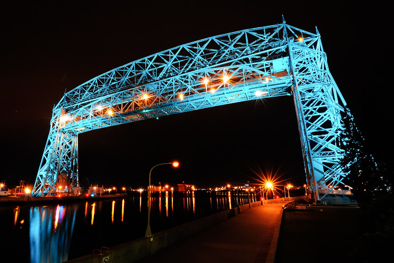 Teal lighted Aerial Lift Bridge with raised road deck