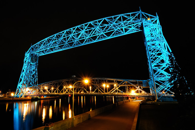 Teal lighted Aerial Lift Bridge with lowered road deck