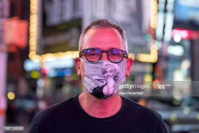 NEW YORK, NEW YORK - JULY 28: A man wearing a Marilyn Monroe mask poses in Times Square as the city continues Phase 4 of re-opening following restrictions imposed to slow the spread of coronavirus on July 28, 2020 in New York City. The fourth phase allows outdoor arts and entertainment, sporting events without fans and media production. (Photo by Alexi Rosenfeld/Getty Images)