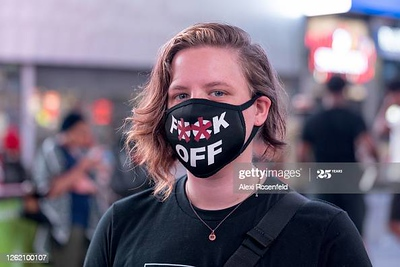 NEW YORK, NEW YORK - JULY 28: (EDITORS NOTE: IMAGE CONTAINS EXPLICIT LANGUAGE) A woman wearing a F**K off mask poses in Times Square as the city continues Phase 4 of re-opening following restrictions imposed to slow the spread of coronavirus on July 28, 2020 in New York City. The fourth phase allows outdoor arts and entertainment, sporting events without fans and media production. (Photo by Alexi Rosenfeld/Getty Images)