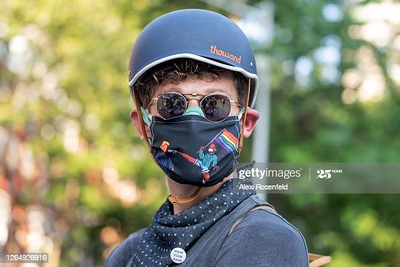 NEW YORK, NEW YORK - AUGUST 09: A person wearing a mask poses in Washington Square Park as the city continues Phase 4 of re-opening following restrictions imposed to slow the spread of coronavirus on August 09, 2020 in New York City. The fourth phase allows outdoor arts and entertainment, sporting events without fans and media production. (Photo by Alexi Rosenfeld/Getty Images)