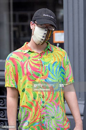 NEW YORK, NEW YORK - JULY 30: A man wearing a mask and a 'Thank u, next' hat poses in SoHo as the city continues Phase 4 of re-opening following restrictions imposed to slow the spread of coronavirus on July 30, 2020 in New York City. The fourth phase allows outdoor arts and entertainment, sporting events without fans and media production. (Photo by Alexi Rosenfeld/Getty Images)