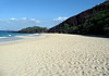 Oneloa Beach - also called Big Beach - with the lower slope of the Pu'u Ola'i, a 360 ft. (110 m) tall volcanic cinder cone beyond - and the Molokini Crater, offshore in the background - South Maui region
