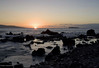 Sunset between the Kaho'olawe Island and the Molokini Crater - with the distal southern flank of Lana'i Island along the distal horizon (R) - from the Ahihi Bay coastline - South Maui region