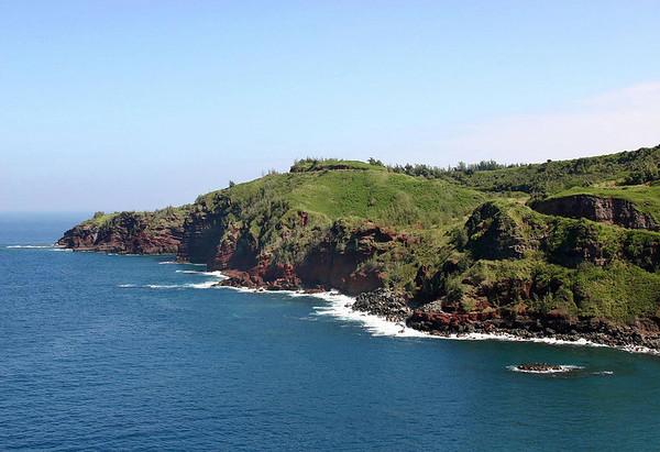 Across Honokohau Bay - and along the iron rich extrusive igneous rock shoreline to Kanounou Point - West Maui region