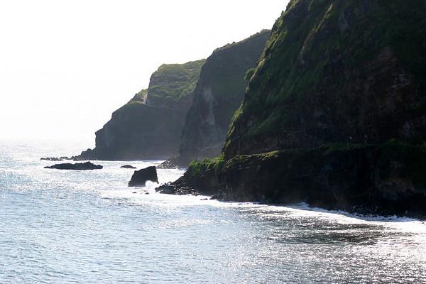 Pi'lani Road - along the volcanic rock cliffs at Lelekea Bay - to the road ascending at Kelepa Point - Haleakala National Park - Southeast island region