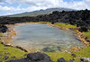 Anticline  pool - is a landlocked body of water with a subterranean connection to the ocean - here upon Cape Kina'u- the Ahihi Kina'u Natural Area Reserve, site of the last lava flow on Maui in 1790 - with the southwestern slope of Mauna Haleakala Volcano in the distance - South Maui region
