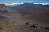 Haleakala Crater, measures about 2 mi. (3.5 km wide), 7.5 mi. (12 km) long, and .5 mi. (.9 km) deep - viewing here, the Ko'olau Gap (about 3.5 mi./5.5 km wide), which is formed between the Kilohana Peak (9,521 ft./2902 m) and Hanakauhi Peak (8,901 ft./2,713 m), (L) - the Kalapawili Ridge, stretching from Hanakauhi Peak to Pohaku Palaha Peak (7,558 ft./2,304 m), (M) - and the Kaupo Gap (about 2 mi./3 km wide), which is formed between Kuiki Peak (7,558 ft./2,304 m) and Haleakala Peak (8,201 ft./2500m), (R) - with numerous cinder cones across the crater floor and the tops of the cumulus clouds beyond - the Haleakala Crater - Upcountry region