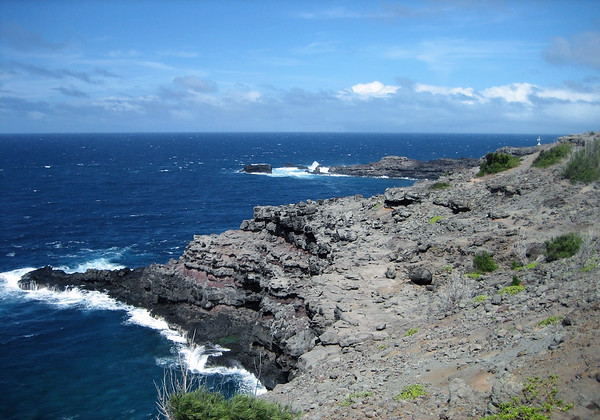 Nakelele Point - the northern most tip of the island of Maui - and across the Pacific towards southern California