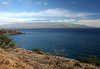 Across Papawai Point - the southern end of West Maui Mountain (Mauna Kahalawai) Volcano - West Maui region - across Ma'alaea Bay - to Mauna Haleakala (House of the Sun Mountain) Volcano, rising to 10,023 ft. (3,055 m) above the Pacific