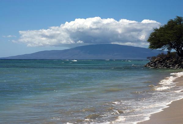 Ukumehame Beach - West Maui region - westward across the Au'au Channel, for about 15 mi. (24 km) to the eastern flank of Lana'i Island, below the cloud bank