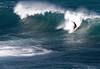 Surfer off the Ako Point near Ku'au Bay (between Ho'okipa Beach and Baldwind Beach - North Shore region
