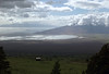 From the cloud-shaded lower western slope of Haleakala - down to the partially sunlit Ma'alaea Bay and isthmus - to the cloud covered southern slope of Mauna Kahalawai (West Maui Mountains) - with Lanai island, in the background