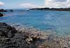 Volcanic rock along the southeast shoreline of Cape Kina'u - across La Peruse Bay - to Hoho'alawe (an uninhabited island) about 7 mi. (11 km) southwest from here - South Maui region
