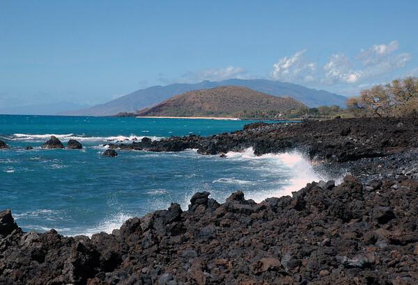 Across Ahihi Bay - to Makena Beach and Pu'u Ola'i cinder cone - South Maui region - with the Mauna Kahalawai (West Maui Mountain) Volcano beyond - and Moloka'i Island, along the distal horizon (L)