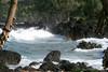 Waves breaking on the extrusive igneous rock shoreline at the Ke'anae Peninsula - Northeast island region