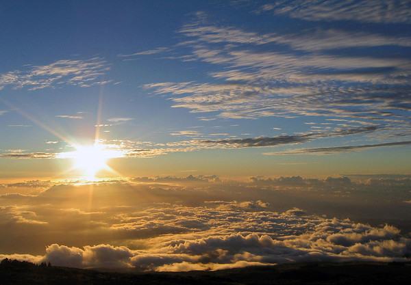 Sunburst at Sunset - from along the slope of the Mauna Haleakala Volcano - with the cumulus clouds below and the stratus and cirrus clouds above - Upcountry region