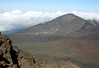 From the western rim of the Haleakala Crater - viewing across the Ko'olau Gap to Hanakauhi Peak - Haleakala National Park - with the Ko'olau Forest Reserve (jurisdiction of the State of Hawaii, Forest Reserve System), about 8,000 ft. (2,438 m) below - Upcountry region