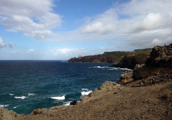 From the cloud-shaded extrusive igneous rock coastline of West Maui region - across the Honokohau Bay - to the Kanounou Point - and Nakalele Point (the northernmost point on Maui) just beyond - with the sunlit Kahakuloa Head, behind the points