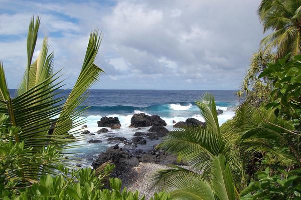 Pacific Ocean waves breaking on the rocky volcanic rock coastline on the Northeast island region