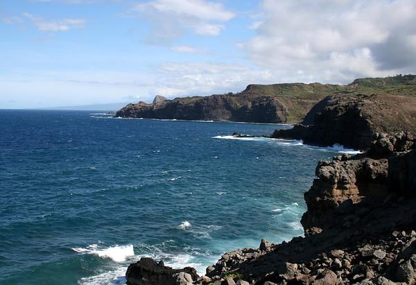 Across Honokohau Bay - to the sheer volcanic cliffs at Kanounou Point - and Nakalele Point (the northernmost point on Maui) just beyond - with Kahakuloa Head, behind the points - and the distal northern flank of Mauna Haleakala Volcano, along the coastal horizon