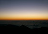 Dawn above the cloud blanket, atop Mauna Haleakala Volcano - Pu'u'ula'ula Summit (Red Hill), rising to 10,023 ft. (3,055 m) - viewing across Haleakala peak 8,201 ft. (2,500 m) the western beginning of the Kaupo Gap - Haleakala National Park - Upcountry region