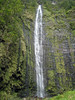 Waimoku Falls, whose source water is the Pipiwai Stream - that plunges about 400 ft. (122 m) along the vertical igneous rock cliff - Haleakala National Park - Southeast island region