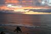 Sunset across the coconut palms and waves breaking at Ka'anapali Beach - West Maui region - across the Au'au Channel - to the northeastern flank of the island of Lana'i
