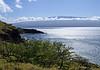 The southern tip of Mauna Kahalawai Volcano, at Papawai Point, South Maui region - across the sun's reflection upon Ma'alaea Bay - to Mauna  Haleakala (which forms about 75% of Maui Island